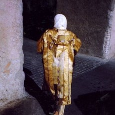 Woman in Gold Coat, Marrakech, From the Morocco Project, 2007, Chromogenic Print, 20 x 24 inches, edition of 10