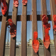 Shoes, U.S. Mexico Border Fence, from The Visitor, Walking 1000 Miles Through Mexico's Cities, 2014, Inkjet Print on Hahnemule Fine Art Paper, 24 x 20 inches, edition of 9.  This image seems like a metaphor, of shoes with no people on the fence separating Mexico and the United States.